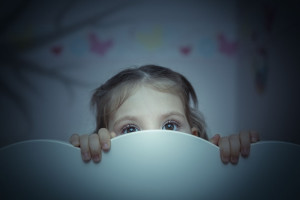 scared little girl in her bed