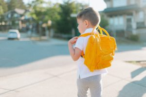 a-little-boy-walking-to-school-with-a-yellow-backpack_t20_lopgj7